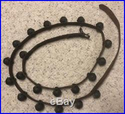 21 Antique Brass Petal Sleigh Bells Shank Style on 88 Leather Buckled Strap
