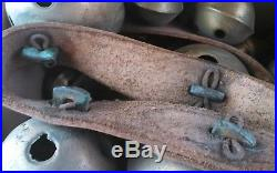 40 antique brass sleigh bells with leather strap