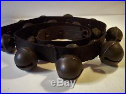 Beautiful 7 feet long antique 27 cast brass petal sleigh bells on leather strap