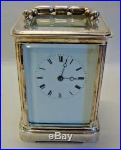 Early 20th century silver plated chiming on bell carriage clock made in France