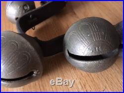 Nineteen graduated Antique Brass Petal/Sleigh Bells from the 1800's