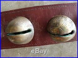 Vintage/Antique 20 Brass Embossed graduated Sleigh Bells on 8'leather strap