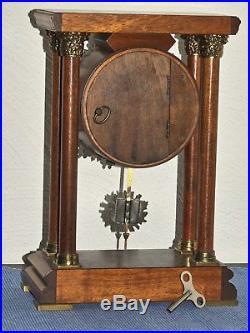 Warmink/Wuba Walnut PILLAR Bracket Clock 8 days Pendulum Movement, 2 bell chimes